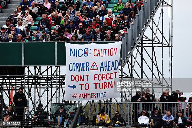 Lewis Hamilton of Great Britain and Mercedes GP fans in a grandstand with a sign for Nico Rosberg of Germany and Mercedes GP during qualifying for...