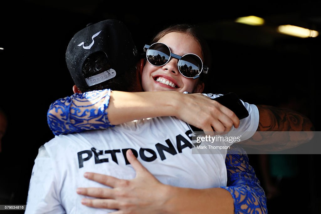 Lewis Hamilton of Great Britain and Mercedes GP gets a congratulatory hug from model Barbara Palvin during the Formula One Grand Prix of Hungary at Hungaroring on July 24, 2016 in Budapest, Hungary.