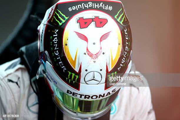Lewis Hamilton of Great Britain and Mercedes GP gets into his car in the garage during final practice for the Formula One Grand Prix of Hungary at...