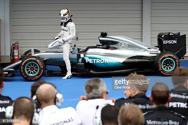 Lewis Hamilton of Great Britain and Mercedes GP in parc ferme after finishing third during the Formula One Grand Prix of Japan at Suzuka Circuit on...