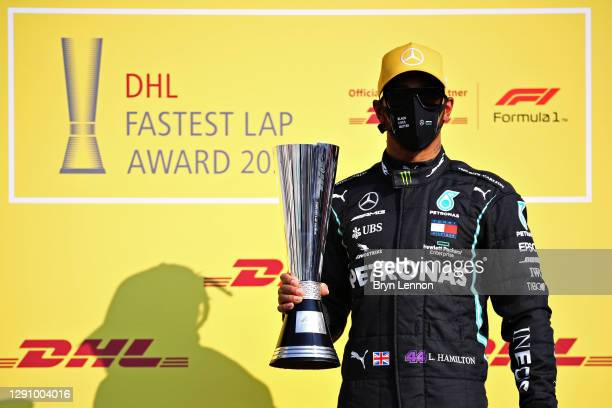 Lewis Hamilton of Great Britain and Mercedes GP is presented with the DHL Fastest Lap Award prior to the F1 Grand Prix of Abu Dhabi at Yas Marina...