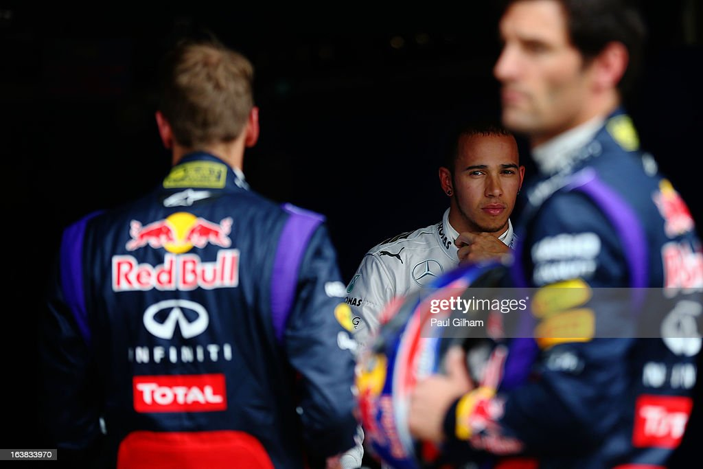 Lewis Hamilton (C) of Great Britain and Mercedes GP is seen in parc ferme after finishing third during the weather delayed qualifying session for the Australian Formula One Grand Prix at the Albert Park Circuit on March 17, 2013 in Melbourne, Australia.
