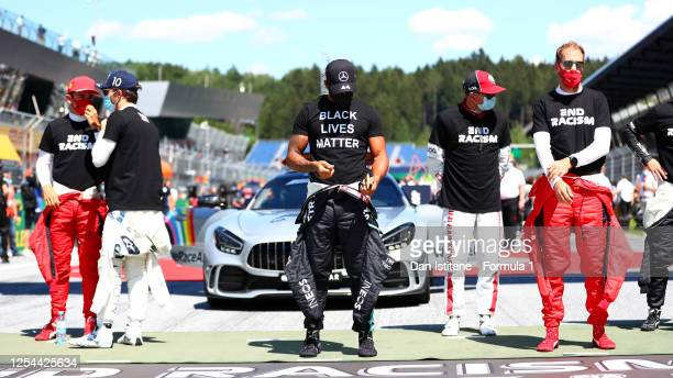 Lewis Hamilton of Great Britain and Mercedes GP is seen wearing a Black Lives Matter t-shirt before the Formula One Grand Prix of Austria at Red Bull...