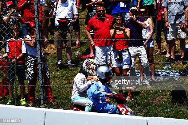 Lewis Hamilton of Great Britain and Mercedes GP is taken back to the pits after crashing on the first lap during the Spanish Formula One Grand Prix...
