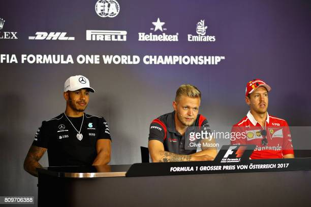 Lewis Hamilton of Great Britain and Mercedes GP Kevin Magnussen of Denmark and Haas F1 and Sebastian Vettel of Germany and Ferrari in the Drivers...
