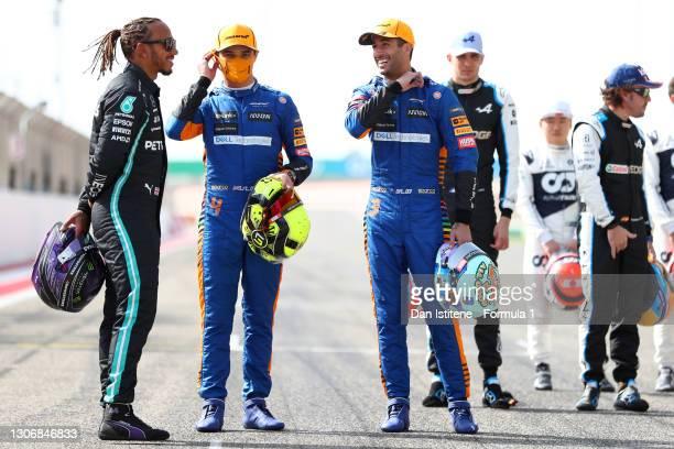 Lewis Hamilton of Great Britain and Mercedes GP, Lando Norris of Great Britain and McLaren F1 and Daniel Ricciardo of Australia and McLaren F1 laugh...