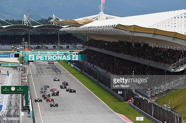 Lewis Hamilton of Great Britain and Mercedes GP leads at the start of the Malaysia Formula One Grand Prix at Sepang Circuit on March 29 2015 in Kuala...