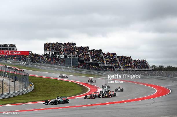 Lewis Hamilton of Great Britain and Mercedes GP leads Daniel Ricciardo of Australia and Infiniti Red Bull Racing Daniil Kvyat of Russia and Infiniti...