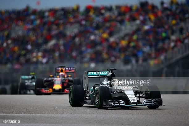 Lewis Hamilton of Great Britain and Mercedes GP leads Daniel Ricciardo of Australia and Infiniti Red Bull Racing during the United States Formula One...