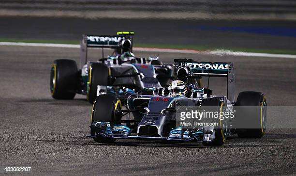 Lewis Hamilton of Great Britain and Mercedes GP leads from team mate Nico Rosberg of Germany and Mercedes GP at the start of the Bahrain Formula One...