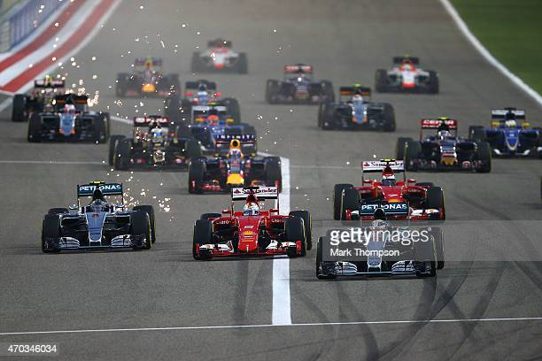 Lewis Hamilton of Great Britain and Mercedes GP leads into the first corner during the Bahrain Formula One Grand Prix at Bahrain International...