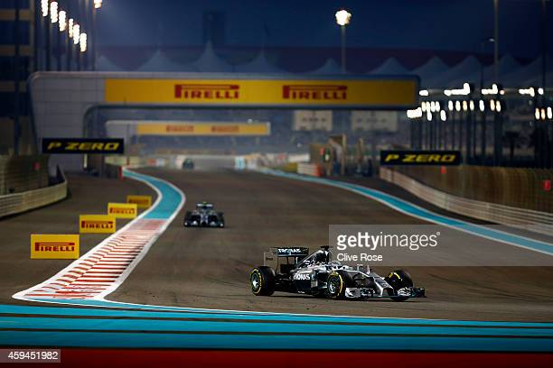 Lewis Hamilton of Great Britain and Mercedes GP leads Nico Rosberg of Germany and Mercedes GP a during the Abu Dhabi Formula One Grand Prix at Yas...