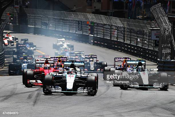 Lewis Hamilton of Great Britain and Mercedes GP leads team mate Nico Rosberg of Germany and Mercedes GP into the first corner at the start of the...
