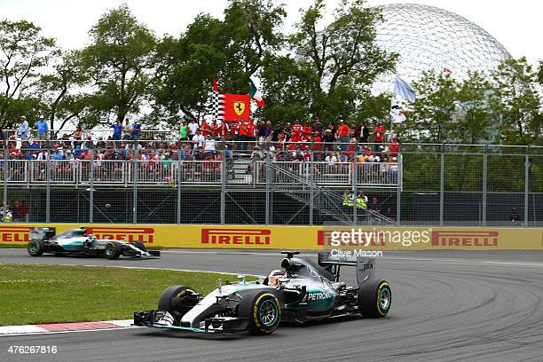 Lewis Hamilton of Great Britain and Mercedes GP leads teammate Nico Rosberg of Germany and Mercedes GP during the Canadian Formula One Grand Prix at...