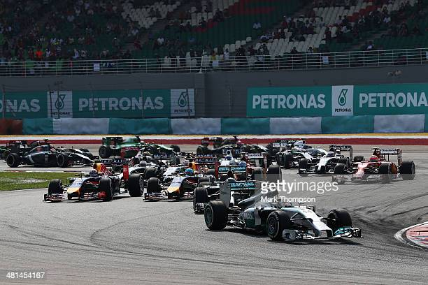 Lewis Hamilton of Great Britain and Mercedes GP leads the field at the start of the Malaysia Formula One Grand Prix at the Sepang Circuit on March 30...