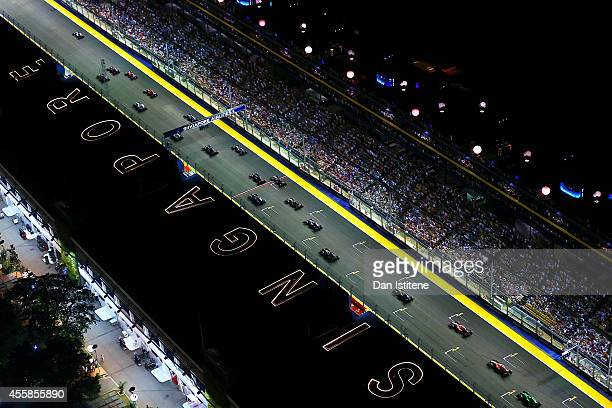 Lewis Hamilton of Great Britain and Mercedes GP leads the field into the first corner during the Singapore Formula One Grand Prix at Marina Bay...