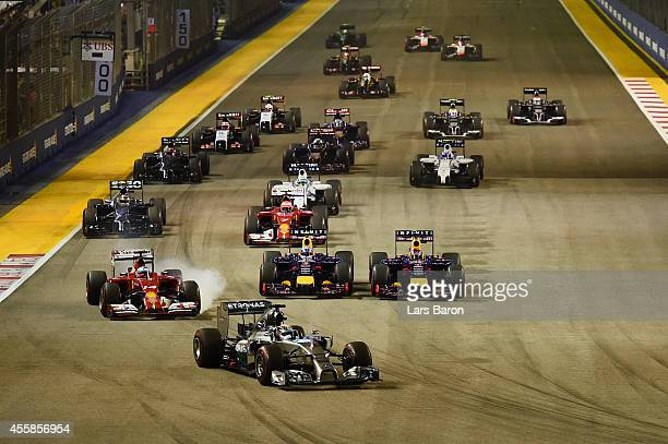 Lewis Hamilton of Great Britain and Mercedes GP leads the field into the first corner as Nico Rosberg of Germany and Mercedes GP starts from the pit...