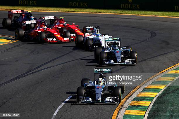 Lewis Hamilton of Great Britain and Mercedes GP leads the field including Nico Rosberg of Germany and Mercedes GP into turn two during the Australian...