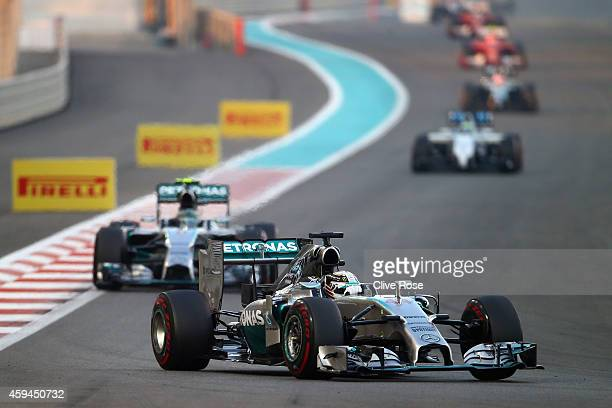 Lewis Hamilton of Great Britain and Mercedes GP leads the field on the opening lap of the Abu Dhabi Formula One Grand Prix at Yas Marina Circuit on...
