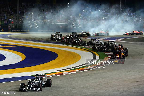Lewis Hamilton of Great Britain and Mercedes GP leads the field out of turn two as drivers lock up during the Singapore Formula One Grand Prix at...