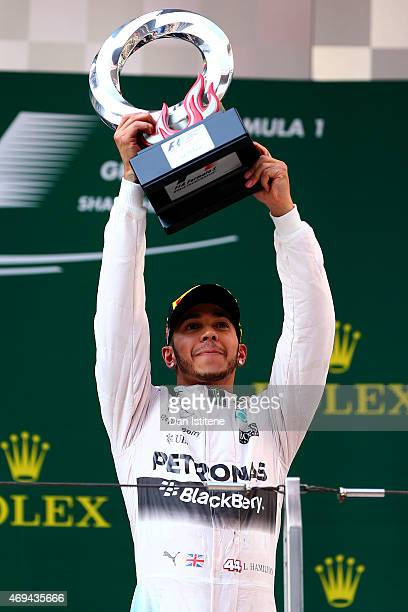 Lewis Hamilton of Great Britain and Mercedes GP lifts the trophy on the podium after winning the Formula One Grand Prix of China at Shanghai...