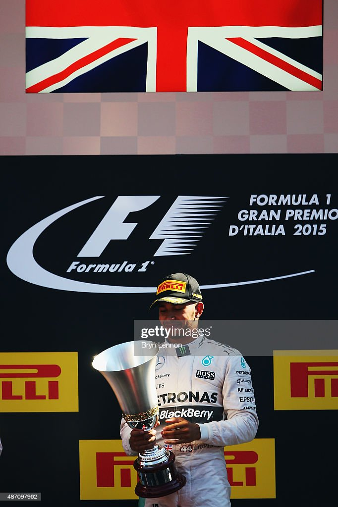 Lewis Hamilton of Great Britain and Mercedes GP lifts the trophy on the podium after winning the Formula One Grand Prix of Italy at Autodromo di Monza on September 6, 2015 in Monza, Italy.