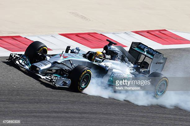 Lewis Hamilton of Great Britain and Mercedes GP locks up as he drives during day three of Formula One Winter Testing at the Bahrain International...