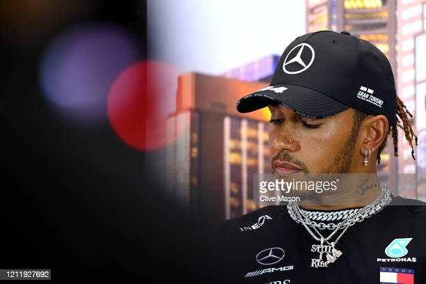 Lewis Hamilton of Great Britain and Mercedes GP looks on during a press conference during previews ahead of the F1 Grand Prix of Australia at...