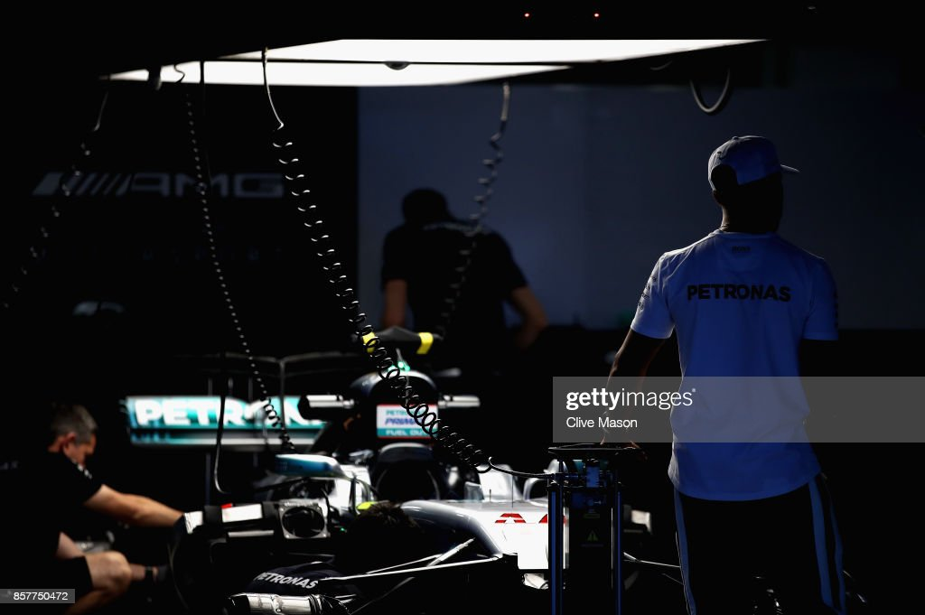 Lewis Hamilton of Great Britain and Mercedes GP looks on in his garage during previews ahead of the Formula One Grand Prix of Japan at Suzuka Circuit on October 5, 2017 in Suzuka.