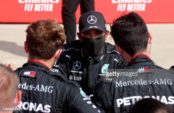 Lewis Hamilton of Great Britain and Mercedes GP looks on in parc ferme during the F1 70th Anniversary Grand Prix at Silverstone on August 09, 2020 in...