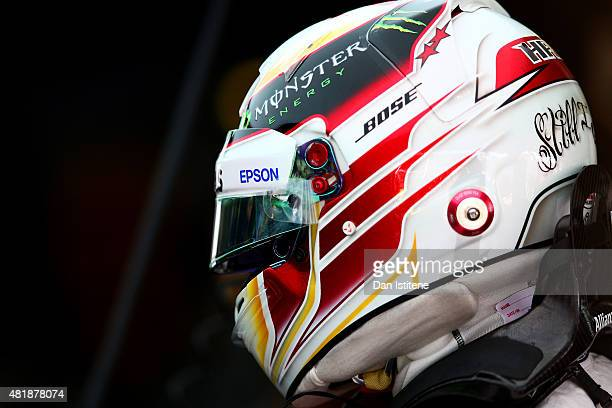 Lewis Hamilton of Great Britain and Mercedes GP looks on in the garage during final practice for the Formula One Grand Prix of Hungary at Hungaroring...
