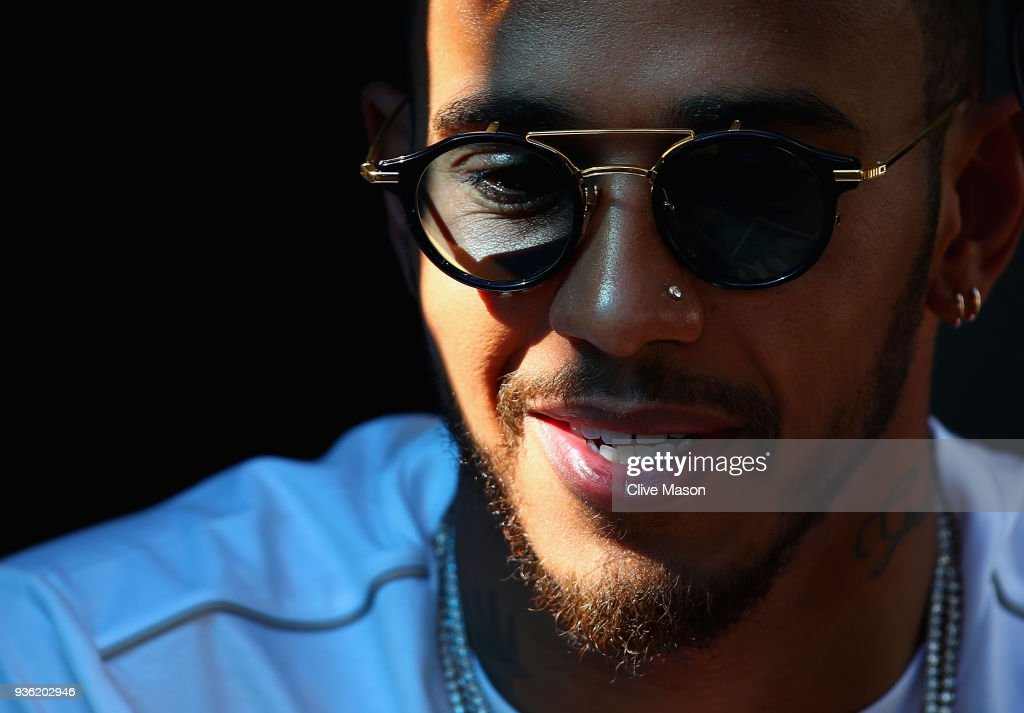 Lewis Hamilton of Great Britain and Mercedes GP looks on in the Paddock during previews ahead of the Australian Formula One Grand Prix at Albert Park on March 22, 2018 in Melbourne, Australia.