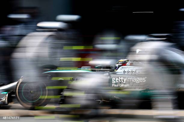 Lewis Hamilton of Great Britain and Mercedes GP makes a pitstop during the Malaysia Formula One Grand Prix at the Sepang Circuit on March 30 2014 in...