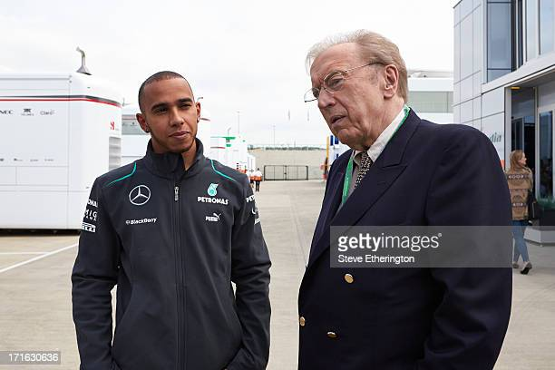 Lewis Hamilton of Great Britain and Mercedes GP meets broadcaster Sir David Frost during previews for the British Formula One Grand Prix at...