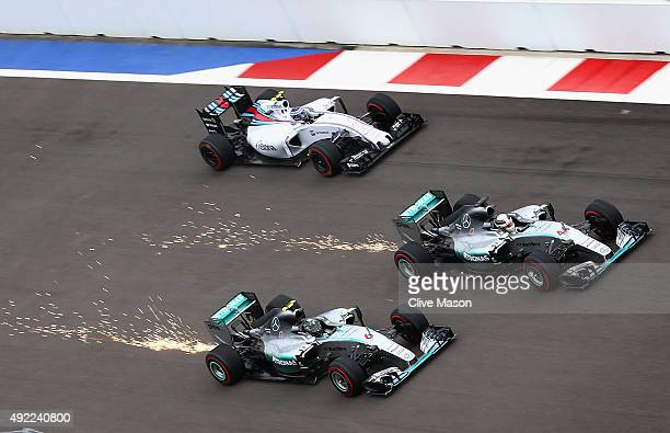 Lewis Hamilton of Great Britain and Mercedes GP Nico Rosberg of Germany and Mercedes GP and Valtteri Bottas of Finland and Williams race into the...