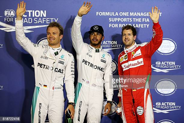 Lewis Hamilton of Great Britain and Mercedes GP Nico Rosberg of Germany and Mercedes GP and Sebastian Vettel of Germany and Ferrari celebrate after...