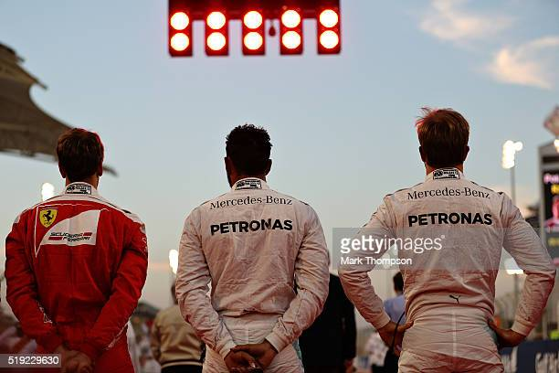 Lewis Hamilton of Great Britain and Mercedes GP Nico Rosberg of Germany and Mercedes GP and Sebastian Vettel of Germany and Ferrari line up on the...