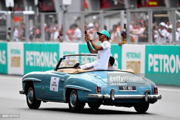 Lewis Hamilton of Great Britain and Mercedes GP on the drivers parade before the Malaysia Formula One Grand Prix at Sepang Circuit on October 1 2017...