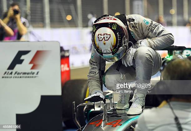 Lewis Hamilton of Great Britain and Mercedes GP pats his car as he celebrates in Parc Ferme after winning the Singapore Formula One Grand Prix at...
