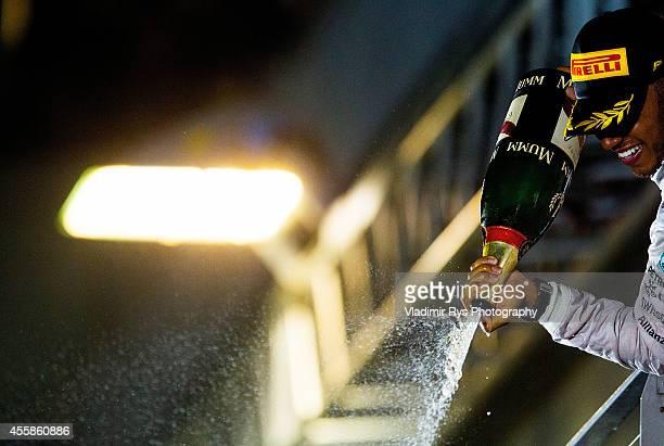 Lewis Hamilton of Great Britain and Mercedes GP Petronas celebrates winning the Singapore Formula One Grand Prix at Marina Bay Street Circuit on...
