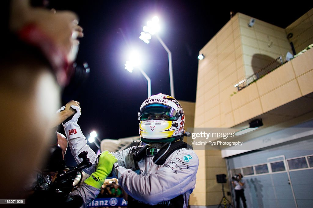 Lewis Hamilton of Great Britain and Mercedes GP Petronas celebrates after winning the Bahrain Formula One Grand Prix at the Bahrain International Circuit on April 06, 2014 in Sakhir, Bahrain.