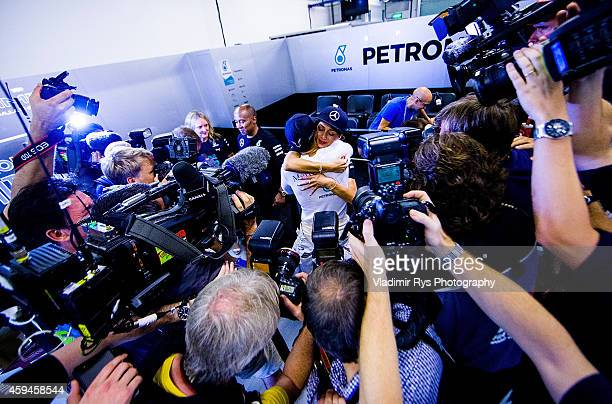 Lewis Hamilton of Great Britain and Mercedes GP Petronas hugs his girlfriend Nicole Scherzinger after becoming World Champion following his win...