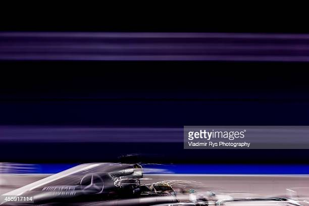 Lewis Hamilton of Great Britain and Mercedes GP Petronas in action during the Singapore Formula One Grand Prix at Marina Bay Street Circuit on...