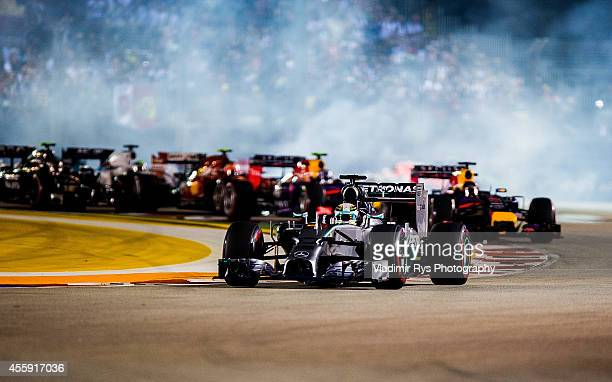 Lewis Hamilton of Great Britain and Mercedes GP Petronas leads after the start of the Singapore Formula One Grand Prix at Marina Bay Street Circuit...