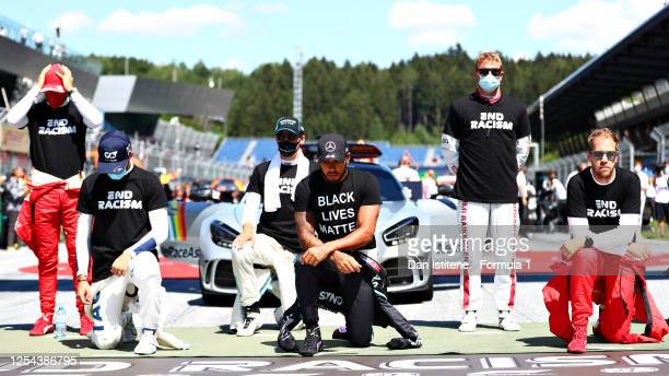 Lewis Hamilton of Great Britain and Mercedes GP Pierre Gasly of France and Scuderia AlphaTauri and Sebastian Vettel of Germany and Ferrari take a...