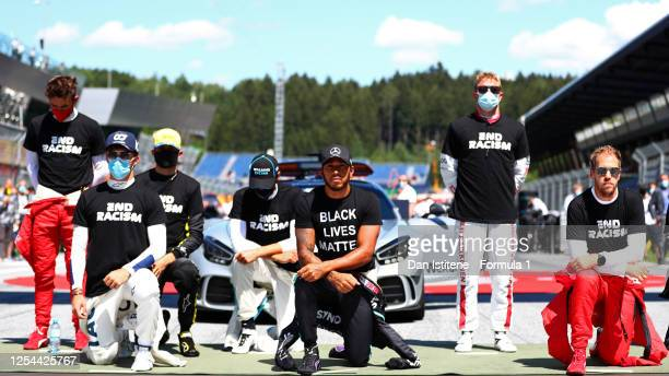 Lewis Hamilton of Great Britain and Mercedes GP, Pierre Gasly of France and Scuderia AlphaTauri and some of the F1 drivers take a knee on the grid in...