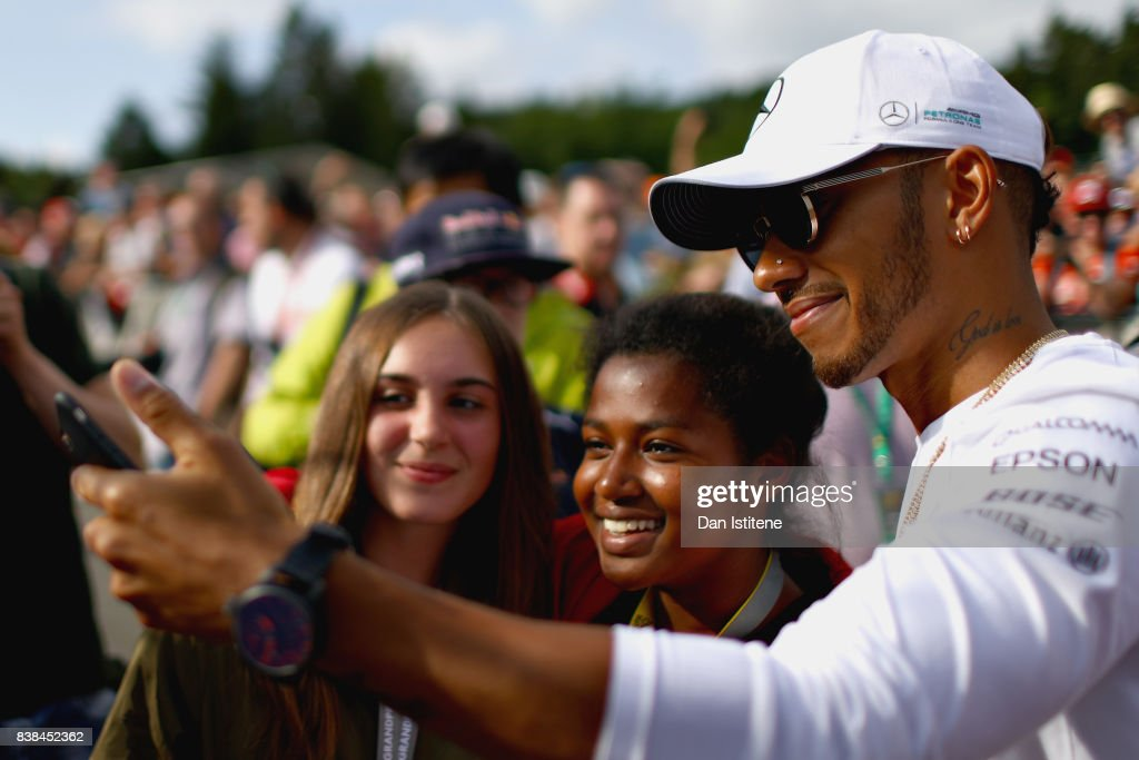 Lewis Hamilton of Great Britain and Mercedes GP poses for a selfie with fans during previews ahead of the Formula One Grand Prix of Belgium at Circuit de Spa-Francorchamps on August 24, 2017 in Spa, Belgium.