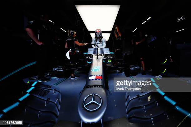 Lewis Hamilton of Great Britain and Mercedes GP prepares to drive in the garage during qualifying for the F1 Grand Prix of Great Britain at...
