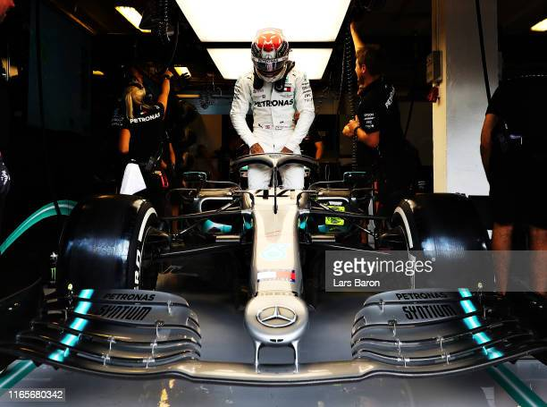 Lewis Hamilton of Great Britain and Mercedes GP prepares to drive in the garage during practice for the F1 Grand Prix of Hungary at Hungaroring on...