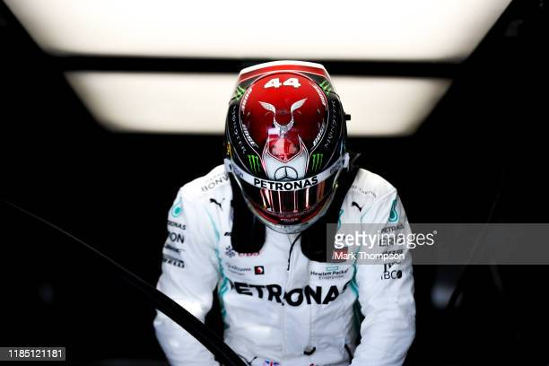 Lewis Hamilton of Great Britain and Mercedes GP prepares to drive in the garage during qualifying for the F1 Grand Prix of USA at Circuit of The...